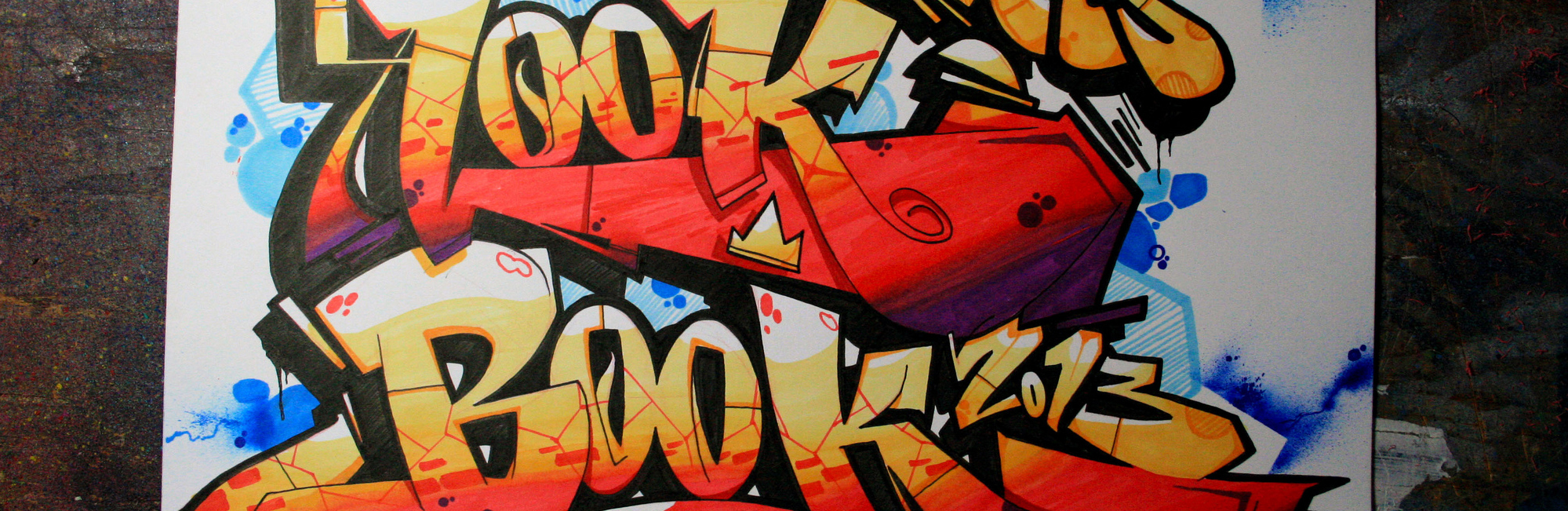 "Graffiti spelling out ""look book"""